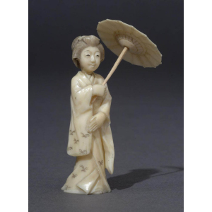 Ivory figure of a woman holding a parasol
